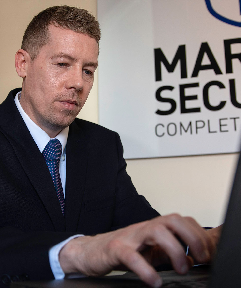 Marpol security Concierge wearing a suit